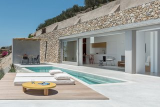 A Modern Home Is Gently Slotted Into a Steep Slope in Santorini