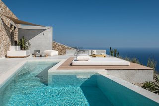 """""""The house is integrated to the cliffside, leaving the least possible imprint,"""" says Marianna Kapsimali, one of the studio's founders."""