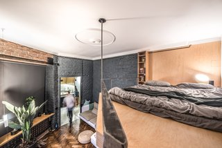 The architects created a lofted sleeping area in order to free up space for the living lounge on the ground floor.