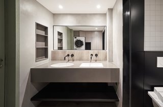 The second bathroom is located within the mezzanine.