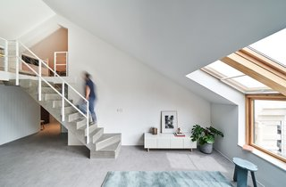 The mezzanine is accessed via an industrial-style concrete staircase.