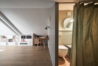 The lofted study is an idyllic addition to the floor plan, especially since the husband regularly works from home.