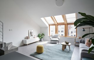 Large wood-framed windows with multi-plane glass help bring more light into the interiors.