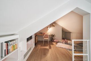 Here, a timber desk is slotted into a cozy corner in the study loft.
