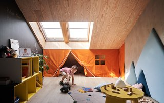 Across from the living lounge, tucked under the mezzanine study, is a child's playroom.