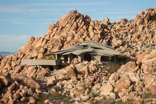 High Desert House is composed of 26 freestanding, concrete columns that look like rib bones.