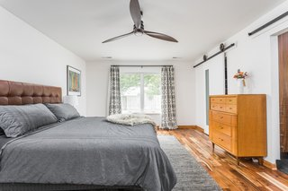 """""""When we found a home with two bedrooms, we figured it would be way more fun to add on a master suite that would meet our needs and also style,"""" notes LeAnne."""