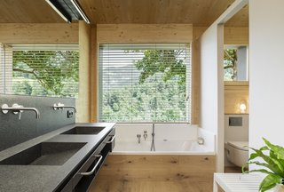 The showers and bathrooms, positioned along the exterior walls, benefit from natural light and ventilation.
