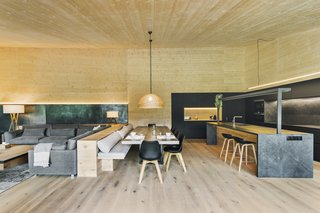 The living, dining, and kitchen spaces flow into one another.