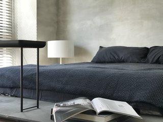 A peek at the minimalist master bedroom.