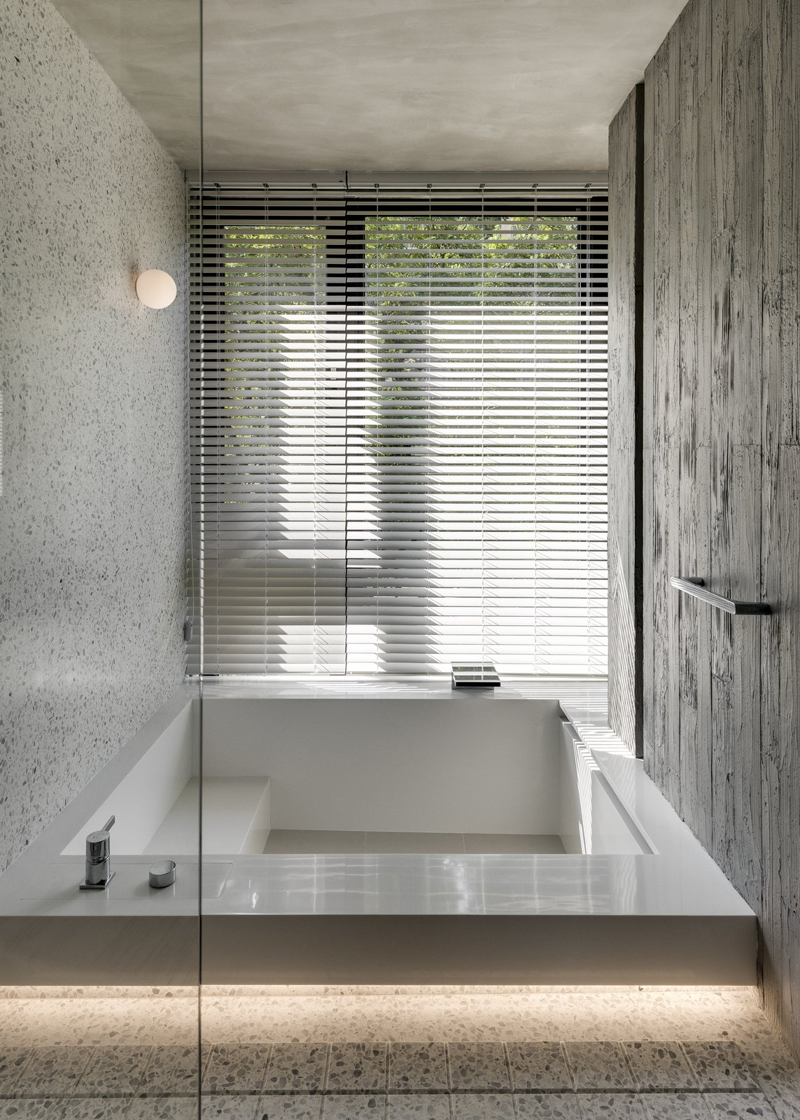 Bath Room and Soaking Tub Various shapes of bespoke lighting have been used to give the interiors a warm, calming atmosphere.    Photo 15 of 16 in A Couple Embrace Wabi-Sabi Design to Travel Back to the Past