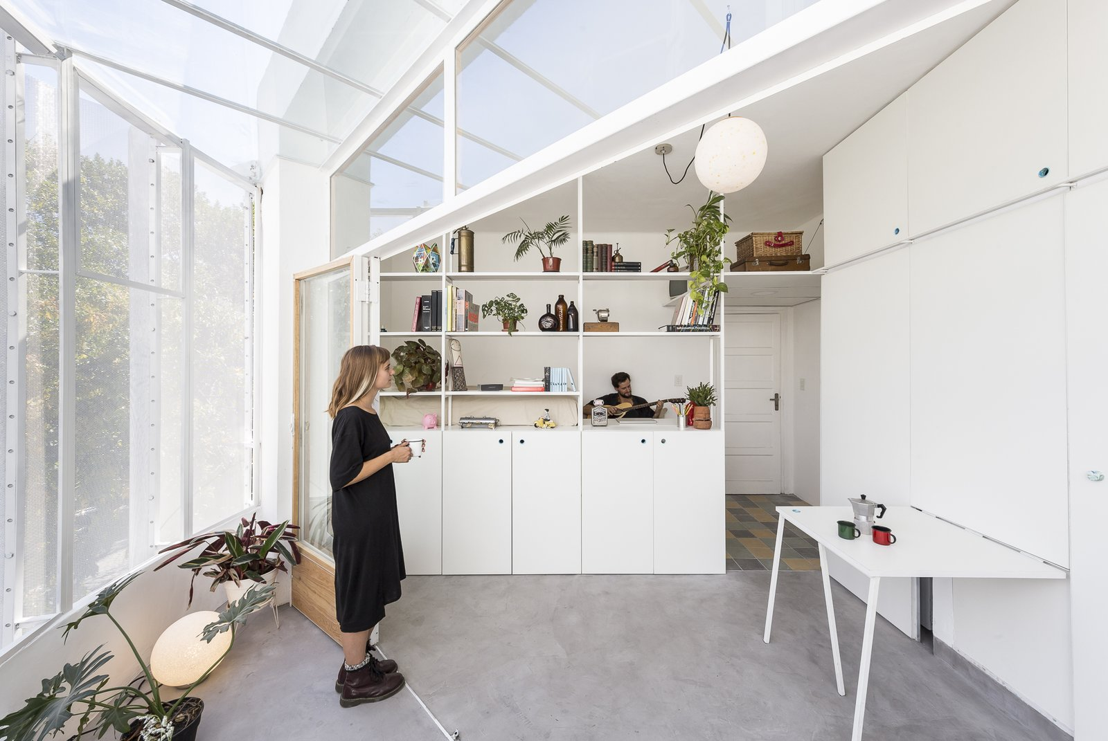 A Perforated Balcony Brings Ample Light Into a Tiny Abode