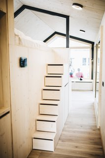 Steps with built-in drawers lead up to the sleeping loft.