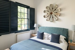 The original sash windows were upgraded, painted a rich blue color, and fitted with a double set of internal Venetian shutters.