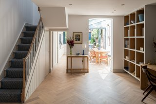 From the landing, a half flight of stairs leads to the two bedrooms on the first floor.