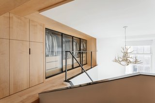 The two lofts are wrapped in maple carpentry, and the warmth of the material works with the compactness of the space to create the most intimate rooms in the apartment.