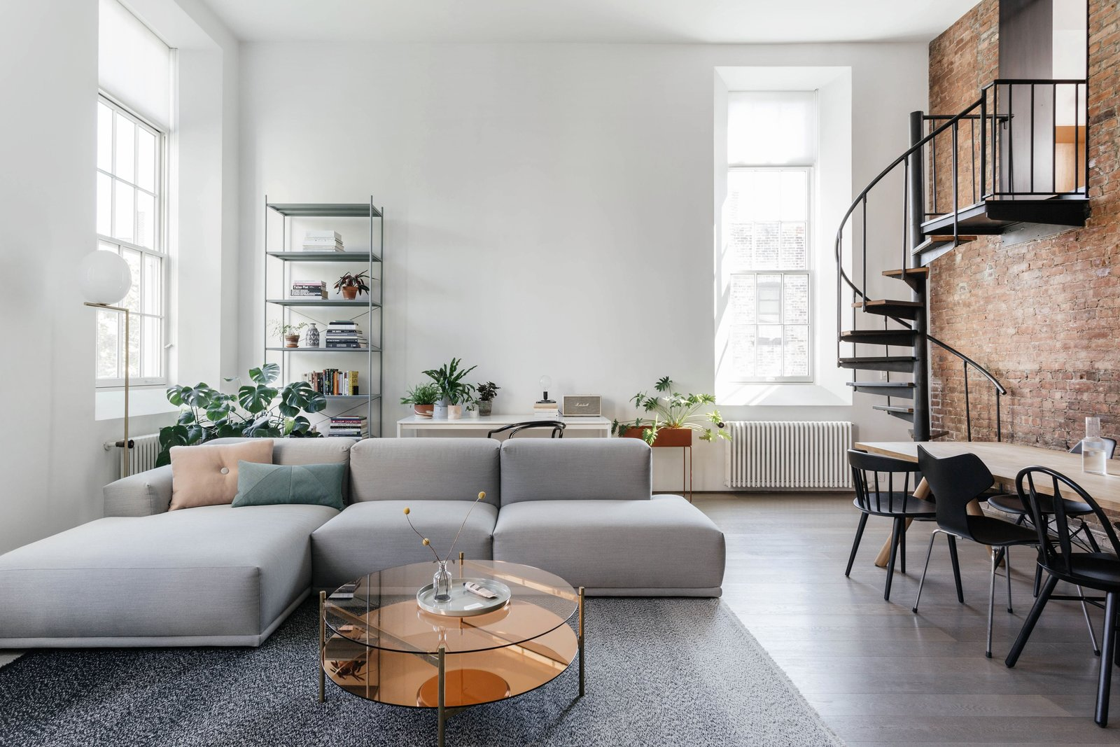 Living, Bookcase, Sofa, Coffee Tables, Medium Hardwood, and Floor  Best Living Bookcase Medium Hardwood Photos from A Small Manhattan Home Gains  Space With Two Cozy Lofts