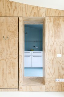 A look at the pinewood-paneled corridor that leads into the kitchen.