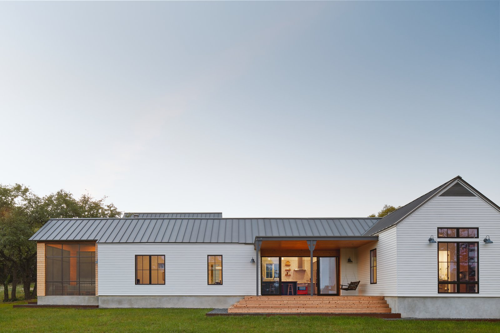 Exterior, Gable RoofLine, Wood Siding Material, House Building Type, Metal Roof Material, and Farmhouse Building Type  Photo 1 of 15 in This Texas Hill Country House Oozes With European Charm