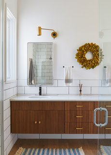 Brass handles and pulls add a touch of luxury to the bathroom.