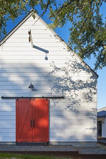 The exterior door adds a pop of color to the subdued white and gray facade.