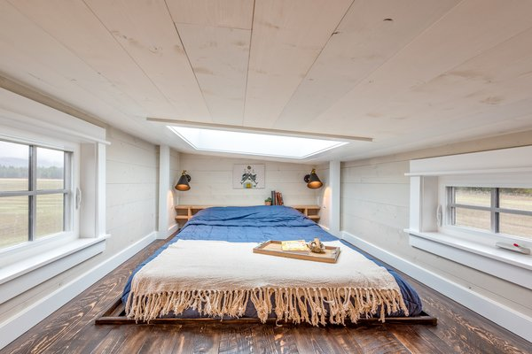 At night, the owners can look up at the stars through the skylight in the lofted bedroom area.