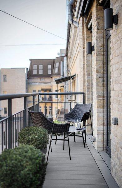 The living room connects to a small balcony.