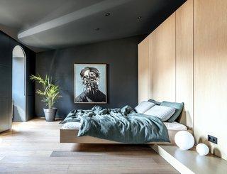 Artwork by Ukrainian artist Bohdan Burenko, and Artemide bedside lamps in the bedroom.