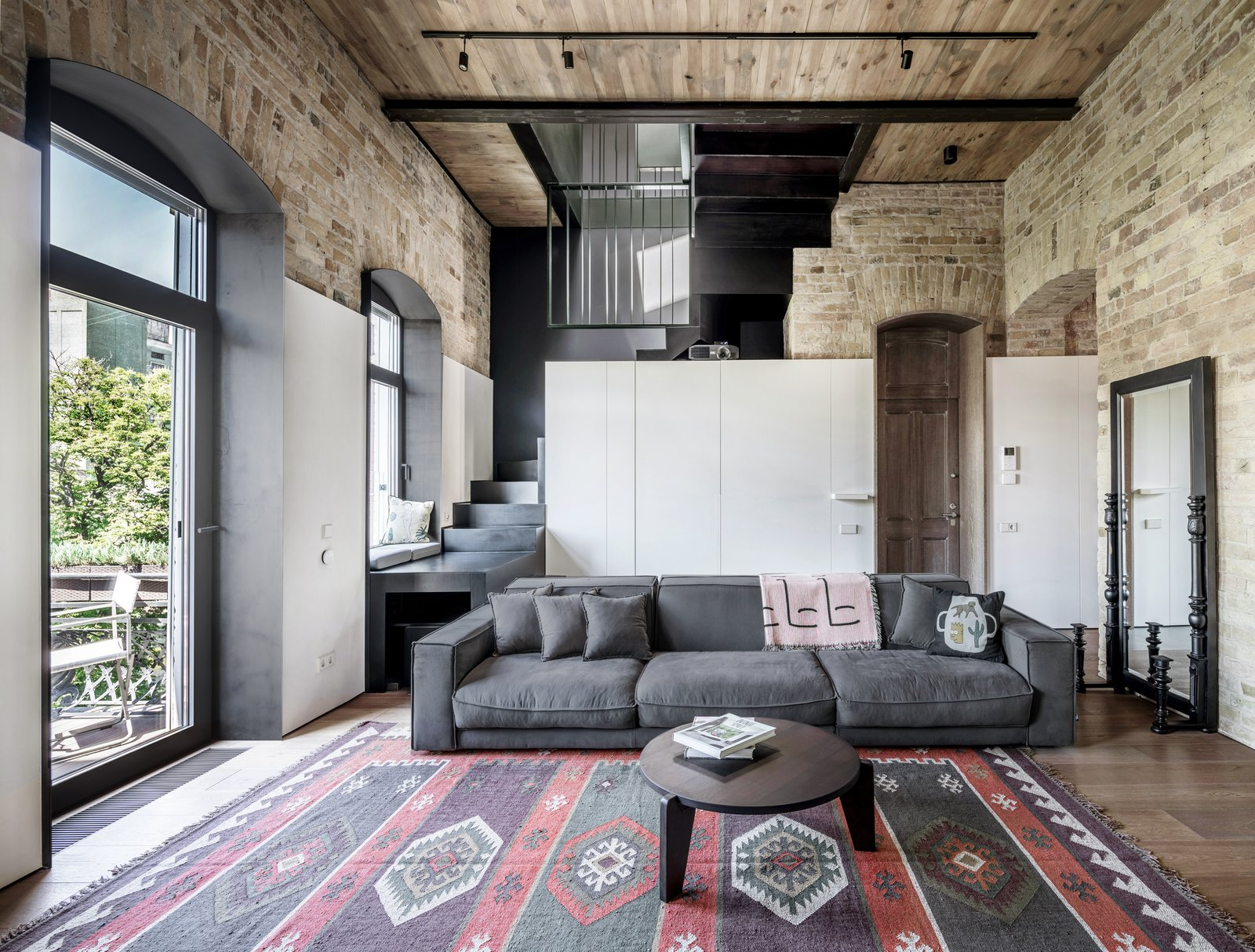A Monochromatic Palette Unifies Old and New in This Ukrainian Bachelor Pad