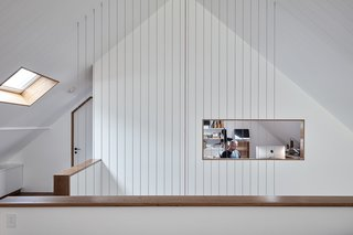 An open mezzanine loft and office space.