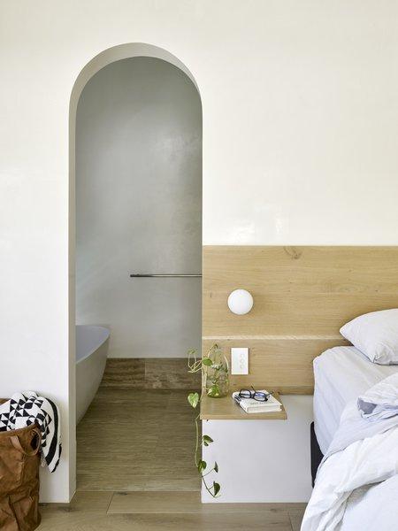 Smaller barrel vaults in the master bedroom create uniformity between the interlocking volumes.