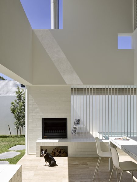 A double-height Outdoor Room  provides opportunities for al fresco living all year long.