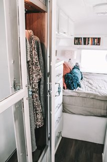 """""""Design strategies we used to maximize space include utilizing the space underneath the bed and the front shelving, and making those areas accessible with additional doors,"""" says Taylor. """"Nate built a hidden shoe cubby into the bed frame, and we left the large hallway closet as is to increase our storage options."""""""