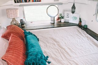 In the bedroom, a Tuft & Needle mattress and bedding from Beddy's rest on a built-in tabletop bed frame, which according to Taylor makes that area so much more practical and useful.