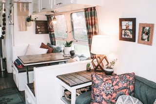 In the dining area hangs an industrial case pendant light shade from Lowes, and macramé wall art from a friend.