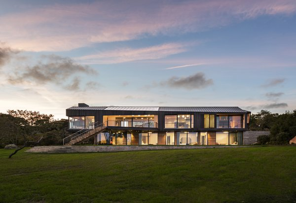 The Chilmark House exterior is clad in shou sugi ban siding and roofed with zinc.