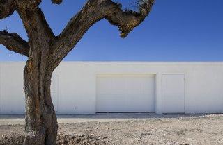 A discreet, white garage door.