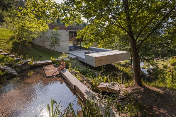 Two Ponds Bookend This Concrete-and-Wood Residence in Portugal