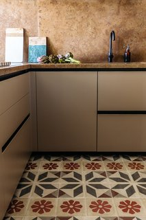 In the kitchen the designers paired ancient Sicilian decorated tiles with a refreshed, modern layout.