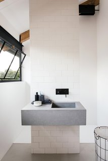 A look at the simple, modern bathroom with a monolithic sink.