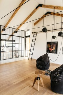 A versatile leisure room connects to a fully-glazed study and work room.