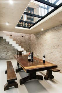 Standing within the conservatory, a glass floor allows one to see through to the wine cellar below, which is accessible via a seamlessly integrated trap door.