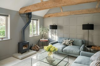 A living lounge with a wood-burning fireplace.