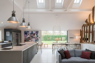 The kitchen features new skylights and a large window in the north elevation to improve light flow into the lofty interiors.