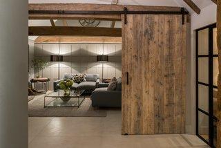 Wooden sliding doors recall barn and farmhouse aesthetics.