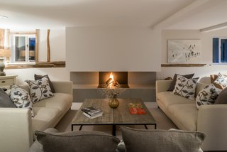 This exposed log-burning fireplace appears as if it has been carved out of the chimney breast.
