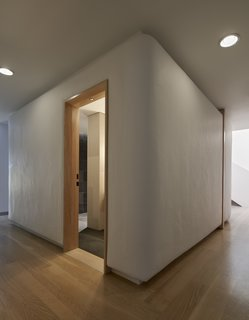 The guest bathroom is contained within a broad column that looks like a marshmallow.