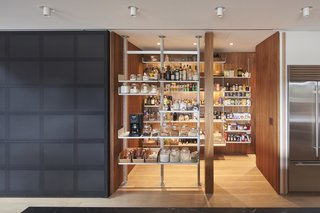 The spacious pantry makes gathering ingredients a convenient, pleasant experience. Dash Marshall designed the custom sliding aluminum door.