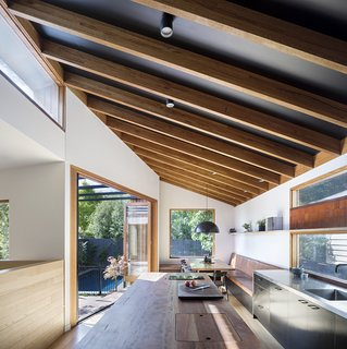 """""""The kitchen itself is generously proportioned, relative to the modest scale of the project, and is centered on the solid Spotted Gum countertop of the kitchen island,"""" says Martin."""