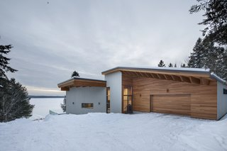 The wood siding gives the house a cabin-like aesthetic.